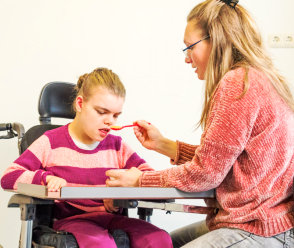 caregiver feeding disable person