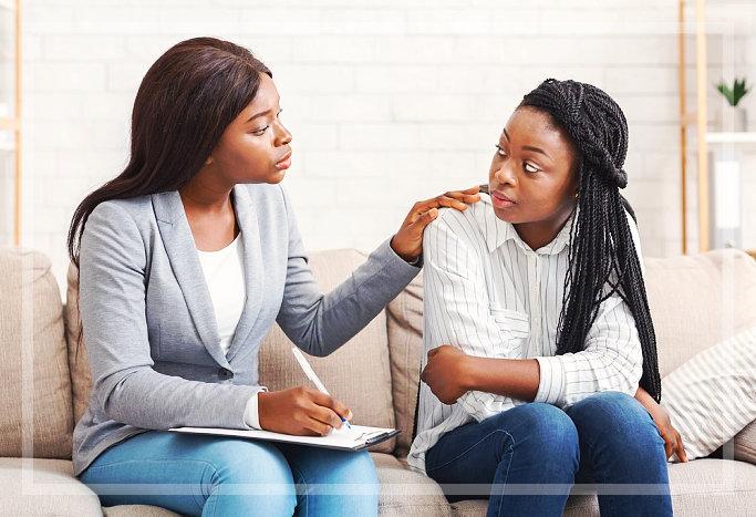 staff advising female teen