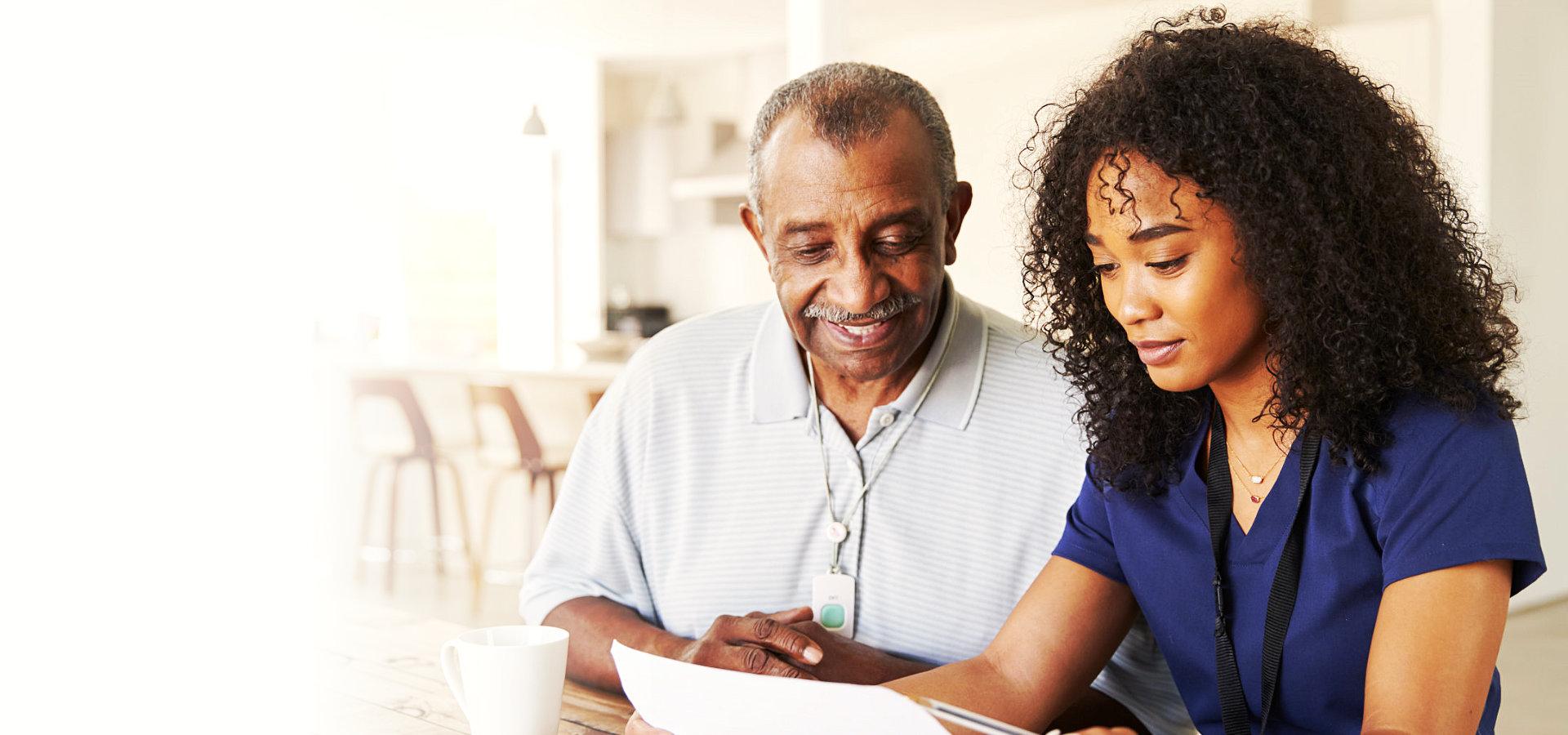 caregiver and elderly man having conversation