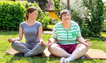 two women meditating
